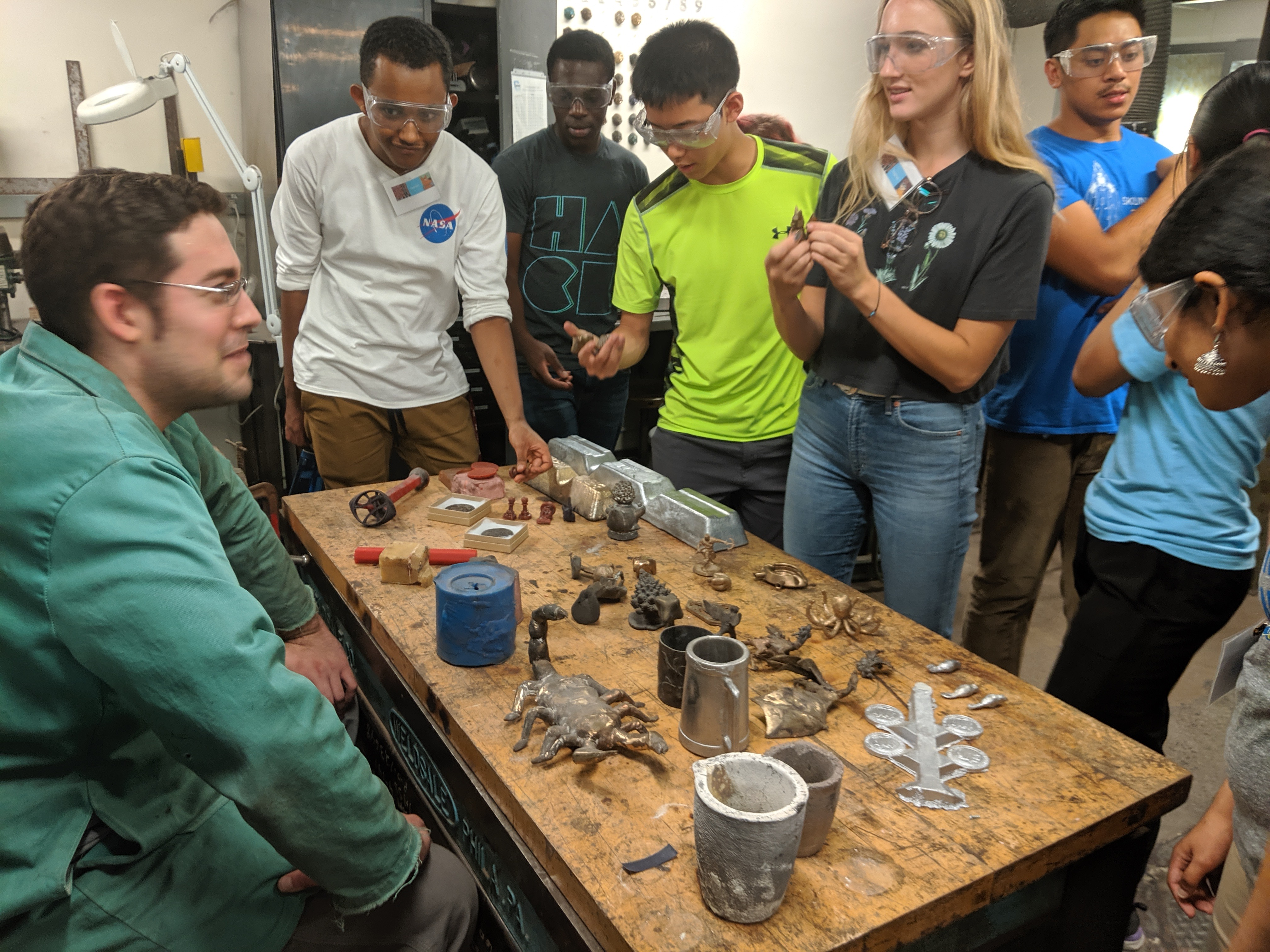 Students learning about metal casting