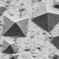 Electron microscope image of crystals forming on a flat surface